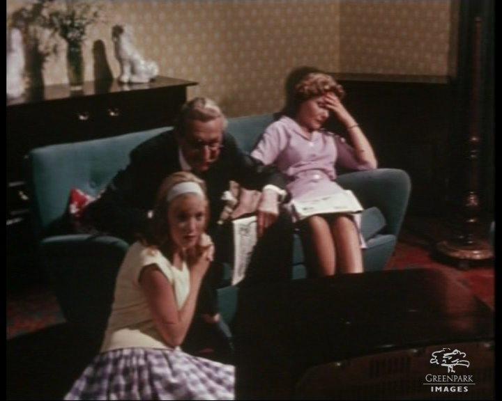 1960s Family watching TV